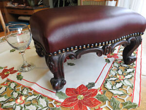 small antique footstool.. new leather and insides