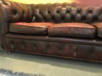 Burgundy leather chesterfield sofa and armchair