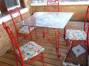 AS NEW GLASS TOP METAL TABLE AND 4 CHAIRS