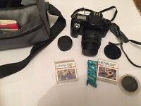 CANON EOS 1000F 35mm FILM CAMERA WITH SIGMA 35-80mm LENS AND BAG