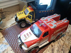 2 Tonka trucks with lights and sound effects