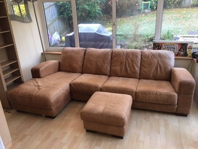 Brown Distressed 4 Seater Leather Sofa With Chaise And Matching Pouffe