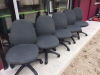 Grey upholstered swivel chair