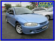 2000 Mitsubishi Mirage CE Blue 5 Speed Manual Hatchback Minto Campbelltown Area Preview