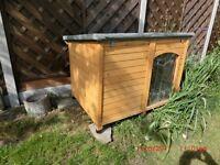 Wooden dog kennel. Collection West Byfleet