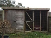 Outdoor kennel with and inside and outside section.