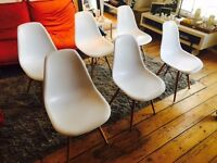 6 chairs Eames Replica. White. Used.