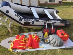Like new Inflatable boat with 20hp Mercury