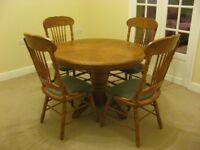 Wooden round dining table & 4 ornate carved back chairs