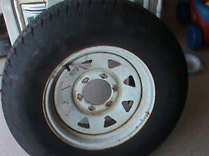 Looking for a GMC battery, trade for trailer tire w/rim 6 holes