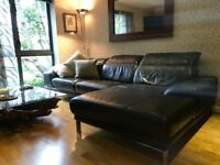 DFS L shaped black leather sofa
