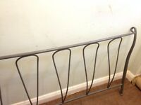 Grey metal bed stand