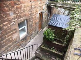 Spacious 2 bedroomed lower ground floor main door flat
