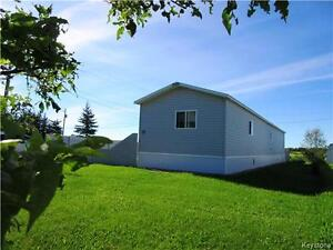 Well maintained 3 BR mobile home and property in Rossburn MB!