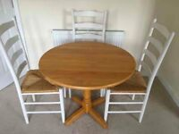Round wooden dining table with 4 chairs