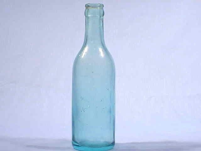 Unusual Aqua Bottle Embossed With 4TH ARTILLERY Insignia