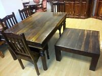 lovely dark brown solid wood dining table and 4 chairs & mach coffee table. very heavy and strong.