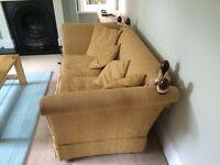 Laura Ashley Medium Sofa in gold with 4 matching cushions.