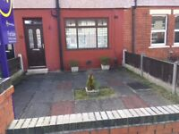 A three bedroom house with two bathrooms for sale.