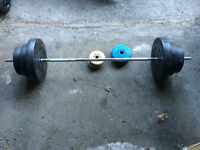 Barbell and 115 lbs of free weights