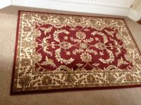 Rugs. Two identical rugs 120cm x 170cm. Dark red with asian style pattern.