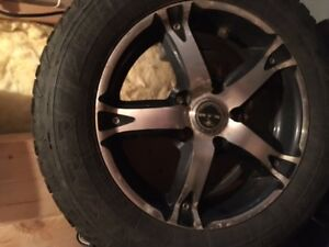 4 Winter tires on alloy rims for sale.