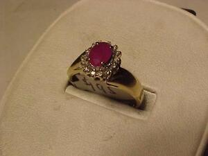 #3183- 14K YELLOW GOLD RUBY/DIAMOND RING SIZE 9 1/8-SELL 195.00-LAYAWAY AVAILABLE-SHIP IN CANADA ONLY-$7.50--