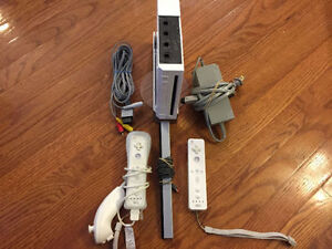 NINTENDO Wii SYSTEM, 30 GAMES, FIT BOARD AND 3 STEERING WHEELS