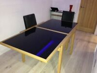 Dining table and 4 leatherette black chairs