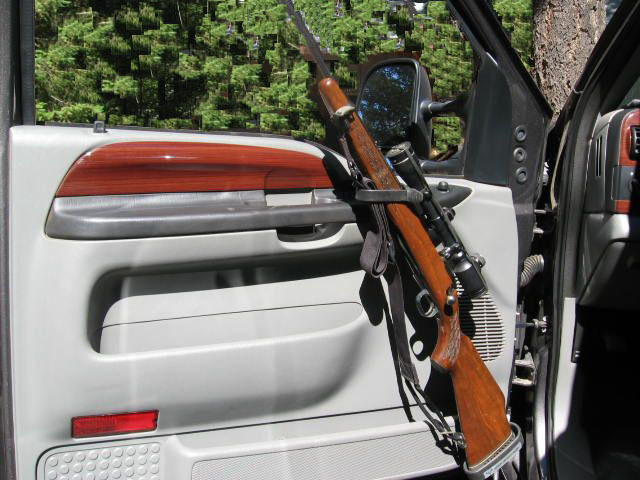 TRUCK INTERIOR DOOR GUN MOUNTING RACKS