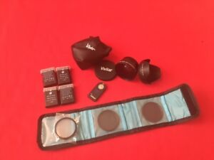 Nikon accessories.Batts, filters, wide ang lens, hood, remote
