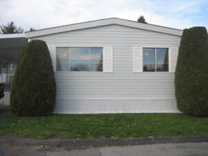 """DOUBLE WIDE AS NEW MOBILE HOME IN ALL AGES """"BREAKAWAY BAYS!!"""