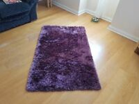 2 rugs: 1 purple rectangular / 1 red circular