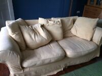 A much loved and extremely comfortable fabric sofa.