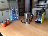 Nespresso Pixie coffee machine. Bialetti frother, 2 cups and various coffee calsules.