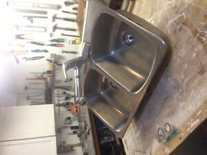 double stainless steel sink and chrome faucet
