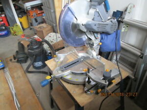 "12"" mitre saw  new cond. and stand"
