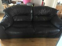 Free Brown leather sofa. Good condition Large two seater. Collection only