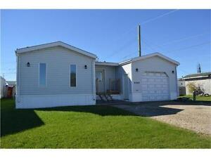 RENOVATED HOME WITH GARAGE! BESIDE SPRAY PARK AND SCHOOL!