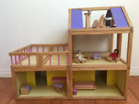 Wooden dolls house with some basic furniture