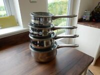Set of four stainless steel saucepans