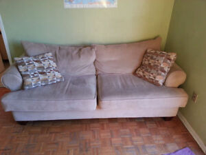 beige couch and soft chair
