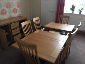 A Large Solid Oak Dining Table -