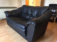 Black leather two seater sofas