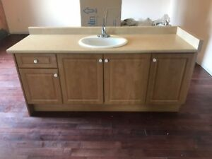 Bathroom Vanity in good condition with sink and faucet