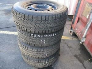 235/70 R16 BF GOODRICH WINTER SLALOM USED WINTER SNOW TIRES W/ MULTI-FIT RIMS (SET OF 4) - APPROX. 99% TREAD