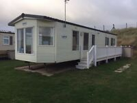 **WONDERFUL HIGH SPEC HOLIDAY HOME FOR SALE ADJACENT TO PRESTATYN'S SANDY BEACH**