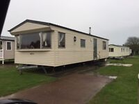 static caravan on 5*park in n wales ,p parking,patio area,3 bed fab new pool great facilities