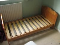 Child's wooden bed, Mattress and a spare, Good condition, some bedding inc small duvet.