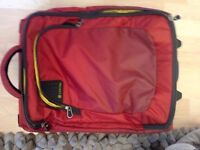 Red carry-on suitcase